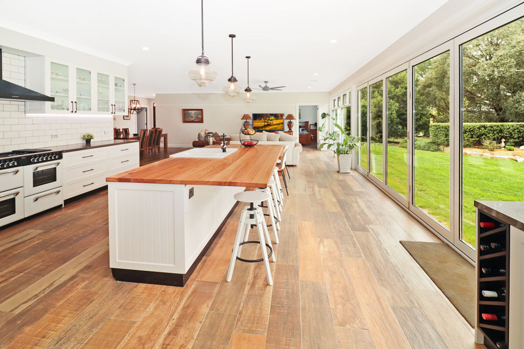 Kitchen dining area with large windows.