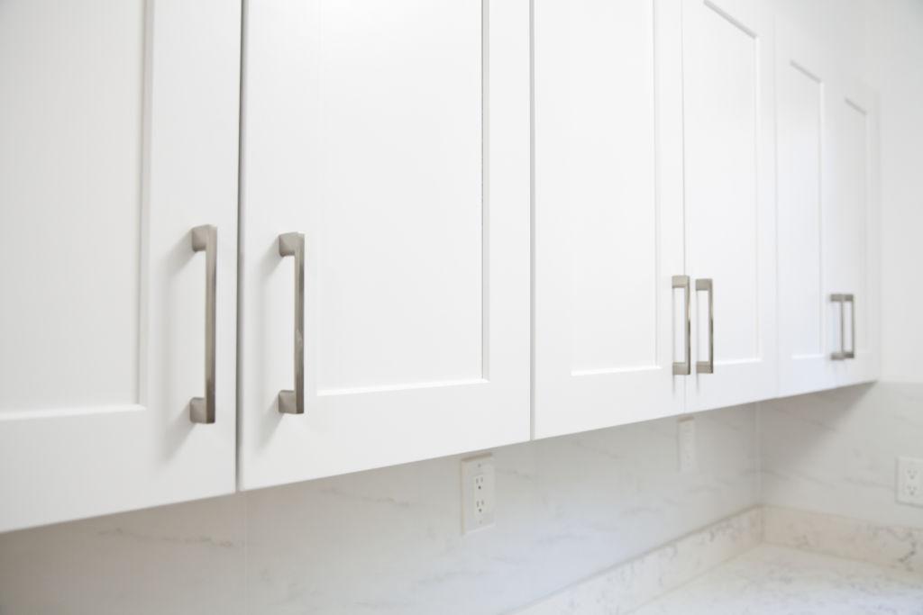 White kitchen cabinet in kitchen