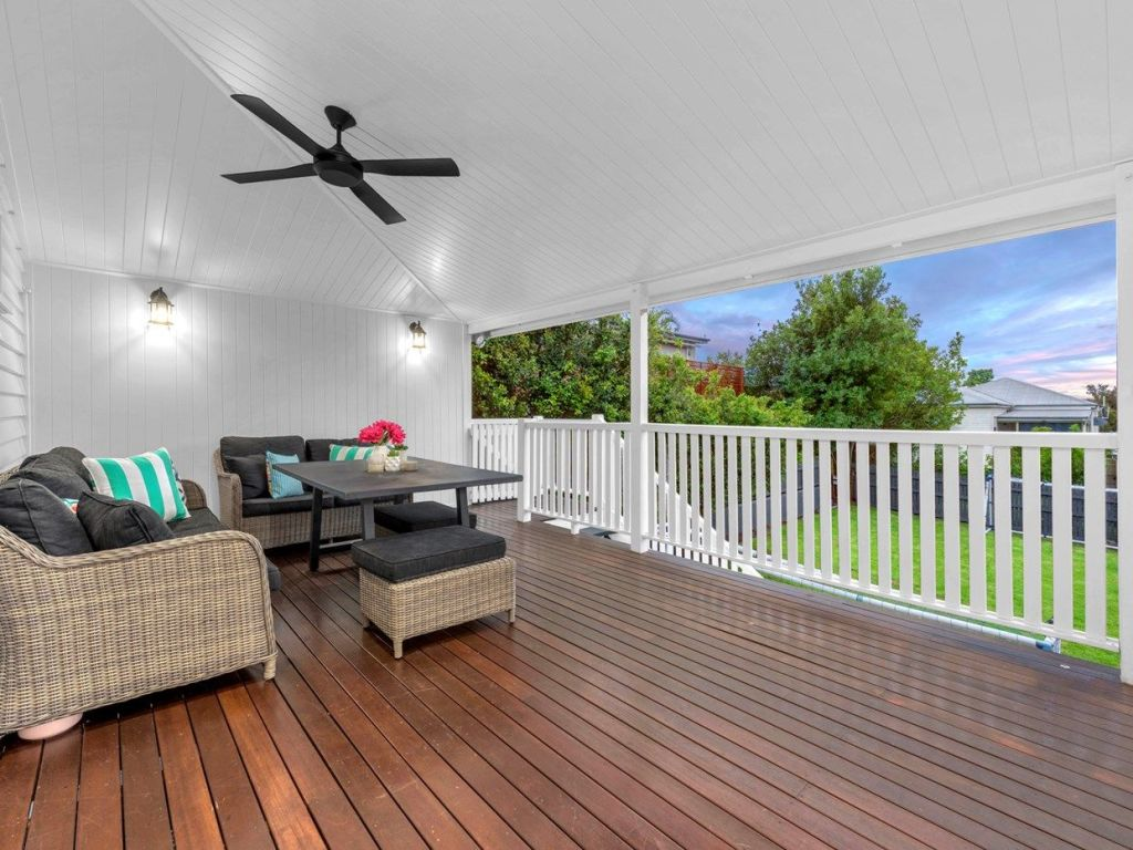 An undercover deck with ceiling fans