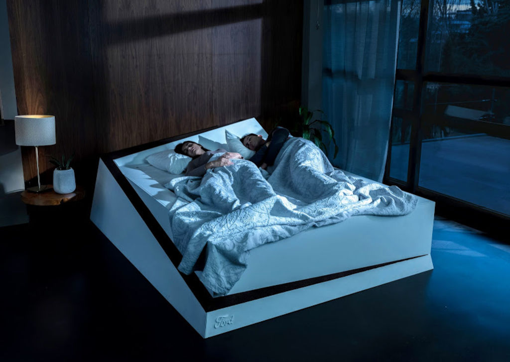 Sensors will detect when you've invaded your partner's space and activate a sort of conveyer belt that will gently shift you back to your side of the bed. Photo: Ford
