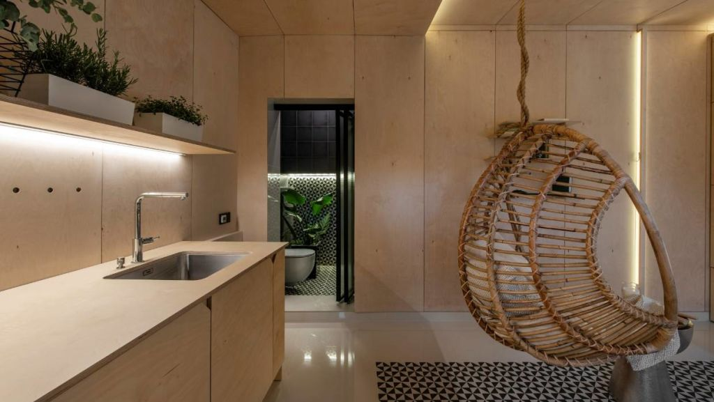A bifolding door beyond the kitchen opens to a petite bathroom.