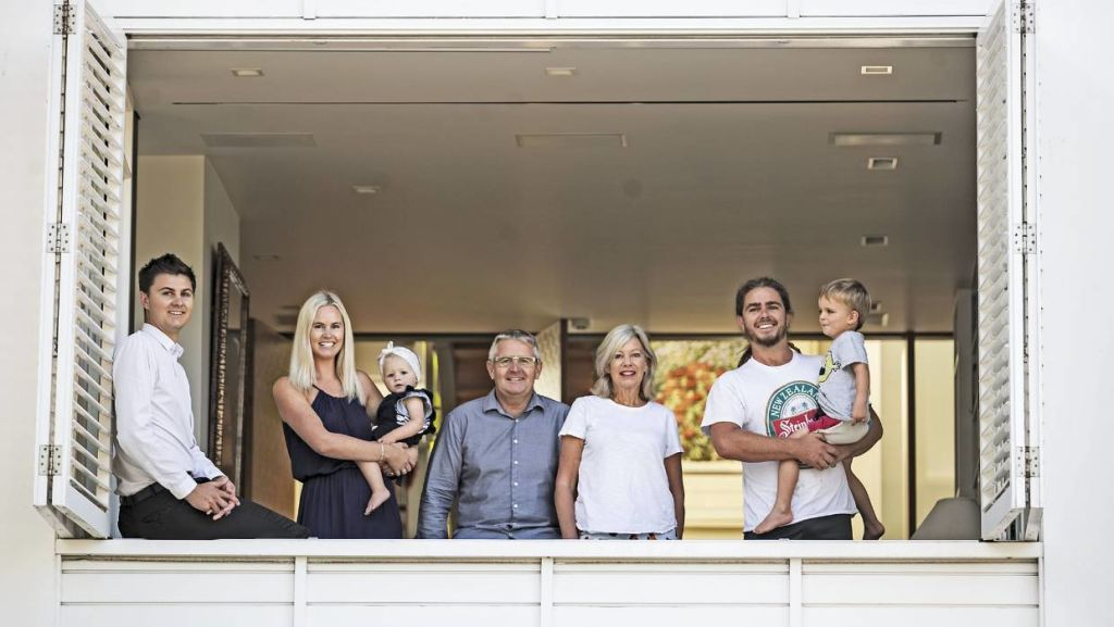 The Aimer-Kelly residence: (From left, son Tom, daughter Gina with granddaughter Mila, Paul, Jane, and son Nick with grandson Louie. All the group and partners have lived in the townhouse at some stage.