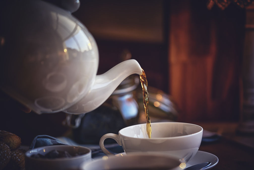 Generic shot of two people sharing a pot of tea