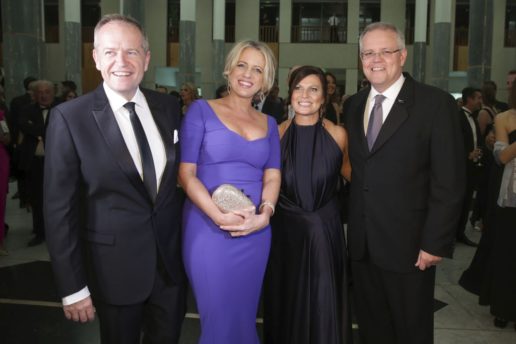 Opposition Leader Bill Shorten and Chloe Shorten with Prime Minister Scott Morrison and Jenny Morrison as they arrive for the Mid Winter Ball at Parliament House in Canberra on Wednesday 12 September 2018. fedpol Photo: Alex Ellinghausen