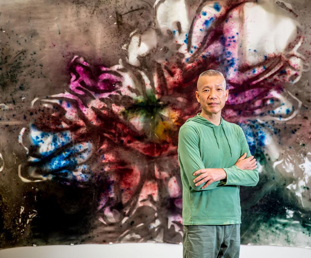 Cai Guo-Qiang with his work Transience II (Peony) 2019. Photo: Tim Carrafa