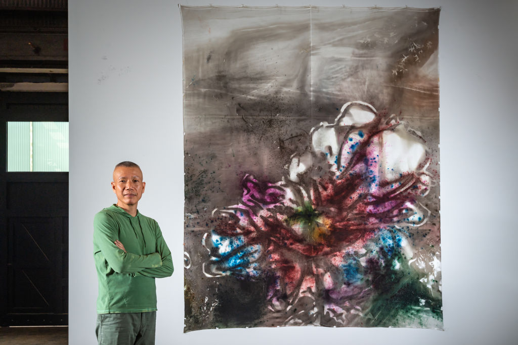 Cai Guo-Qiang with his work Transience II (Peony) 2019. Photo: Jason Edwards