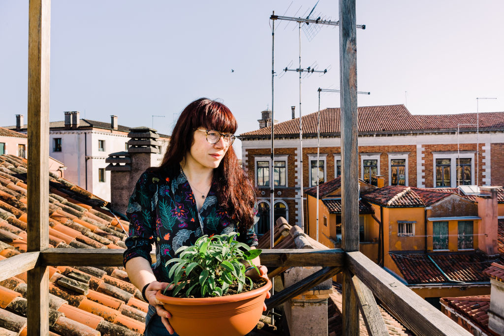 Elena_with_her_sage_plant._She_loves_to_grow_aromatic_plants_on_her_terrace_ii3jpg