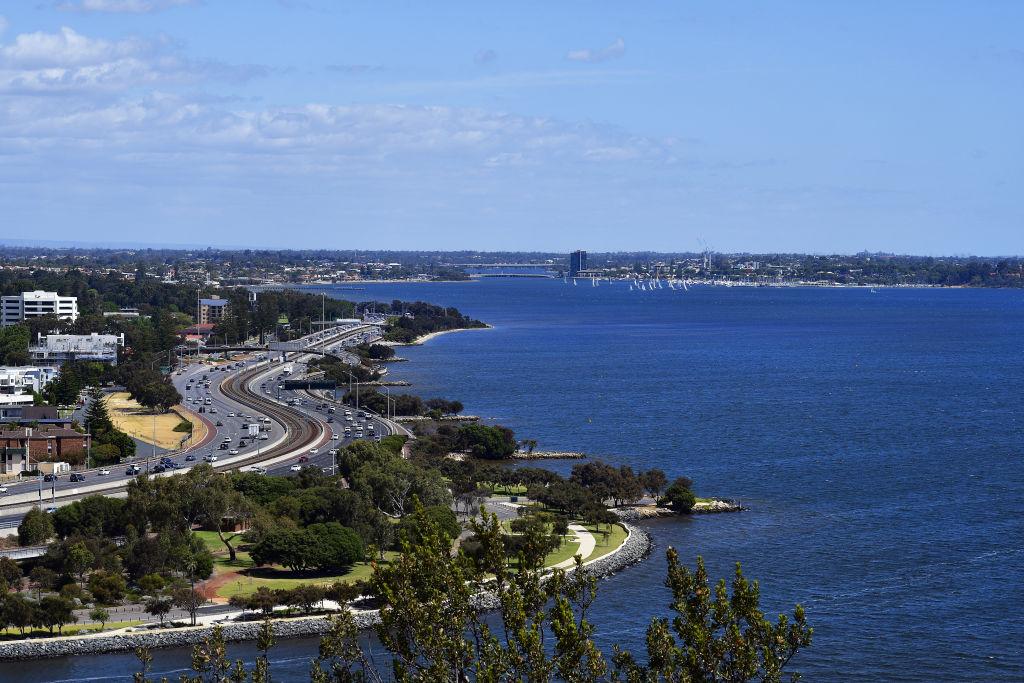 Australia, Perth, Swan river and traffic on Kwinana Freeway - road to Fremantle