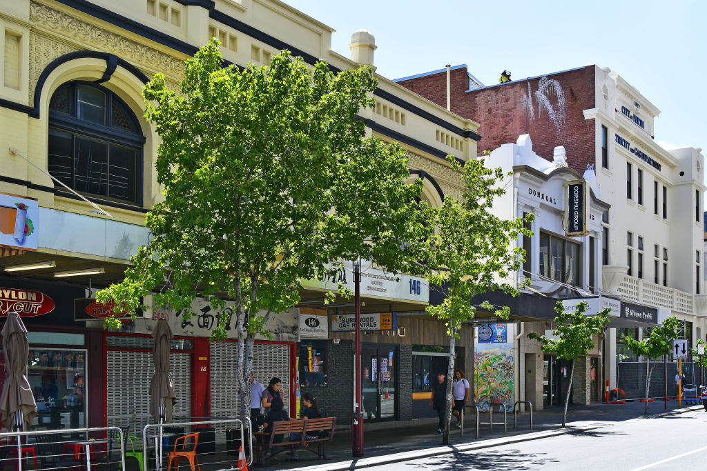 Perth, WA, Australia - November 30, 2017: Unidentified people, shops and buildings in Murray street in the capital from Western Australia