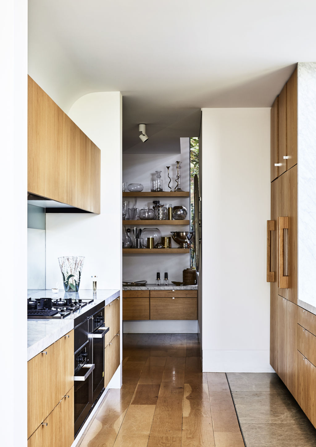 'I have a love of vases! This one in our kitchen is Dior', tells Deborah.Styling: Annie Portelli.