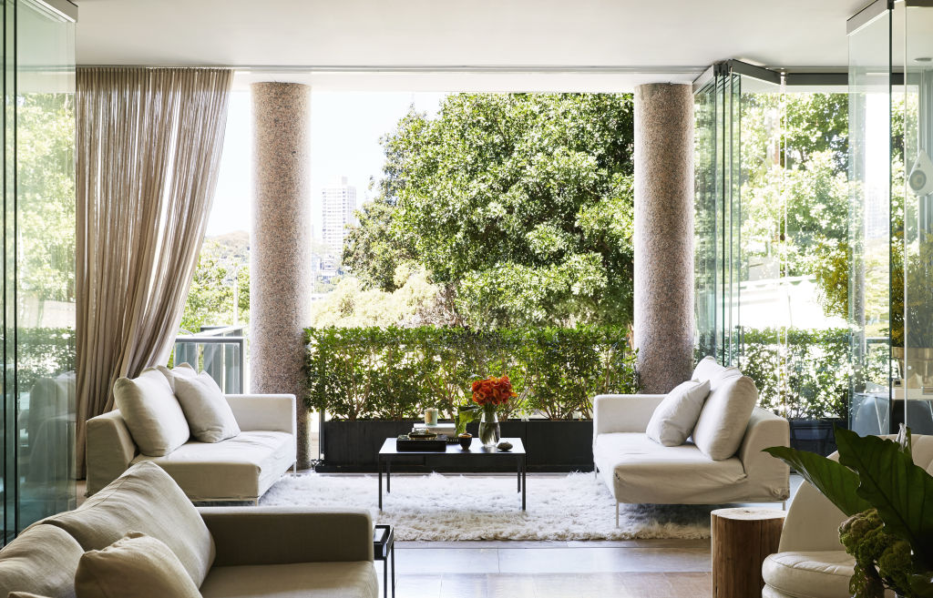 The resplendent balcony and view over Elizabeth Bay! 'The Winter Garden is my favourite area of the house – our little sanctuary', Deborah says. MCM House Couches and coffee table. Styling: Annie Portelli.