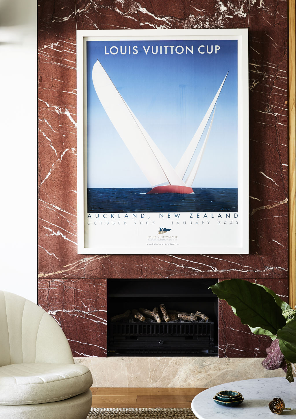 The sitting room. 'My husband loves sailing and this poster was a gift I gave him for his birthday about 10 years ago. It's moved around with him, and has a lovely family connection', Deborah says. Styling: Annie Portelli.