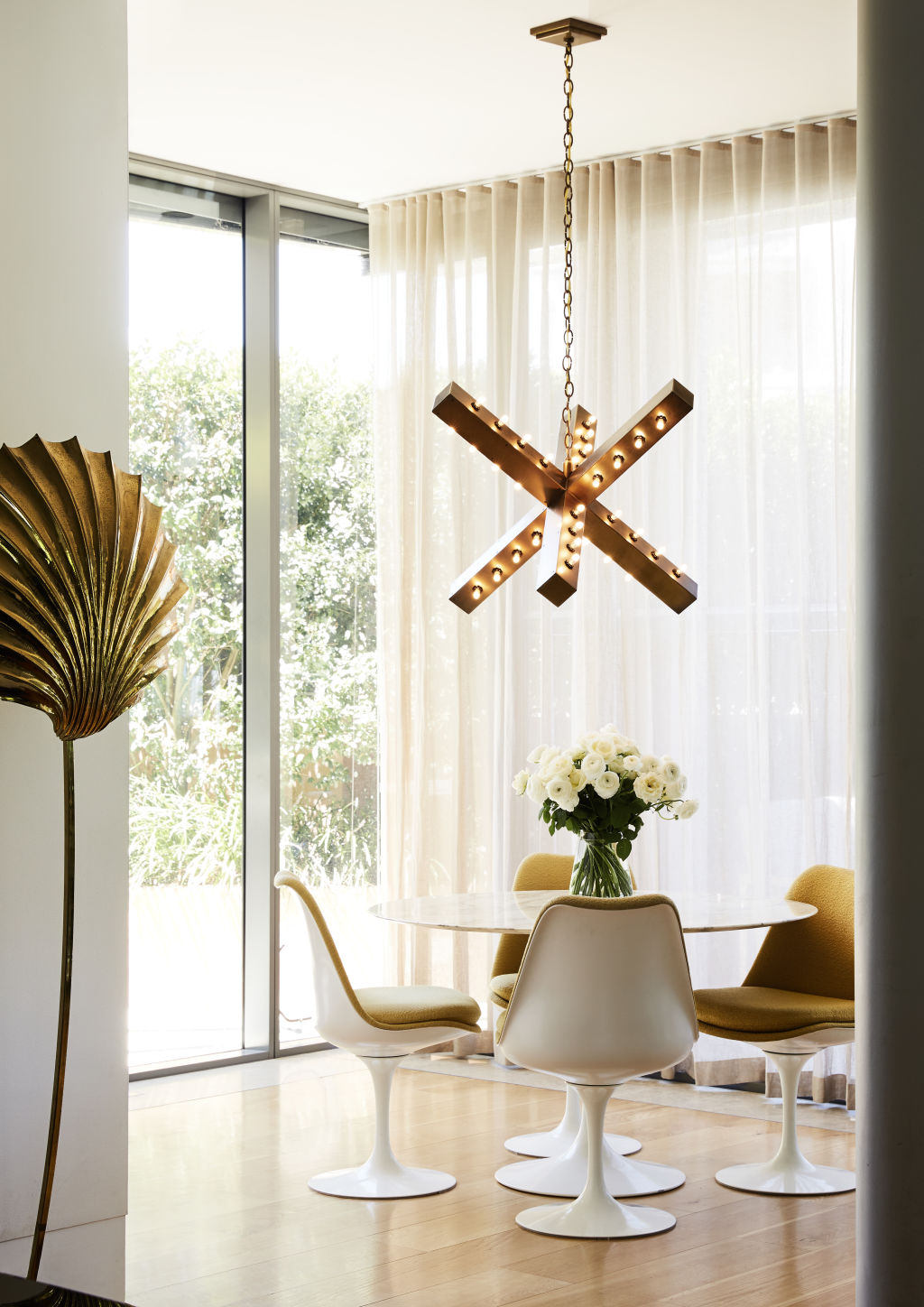 X Lamp in the breakfast room sourced by Poco Designs via Downtown 20 in LA. Vintage table and chairs. Styling: Annie Portelli.
