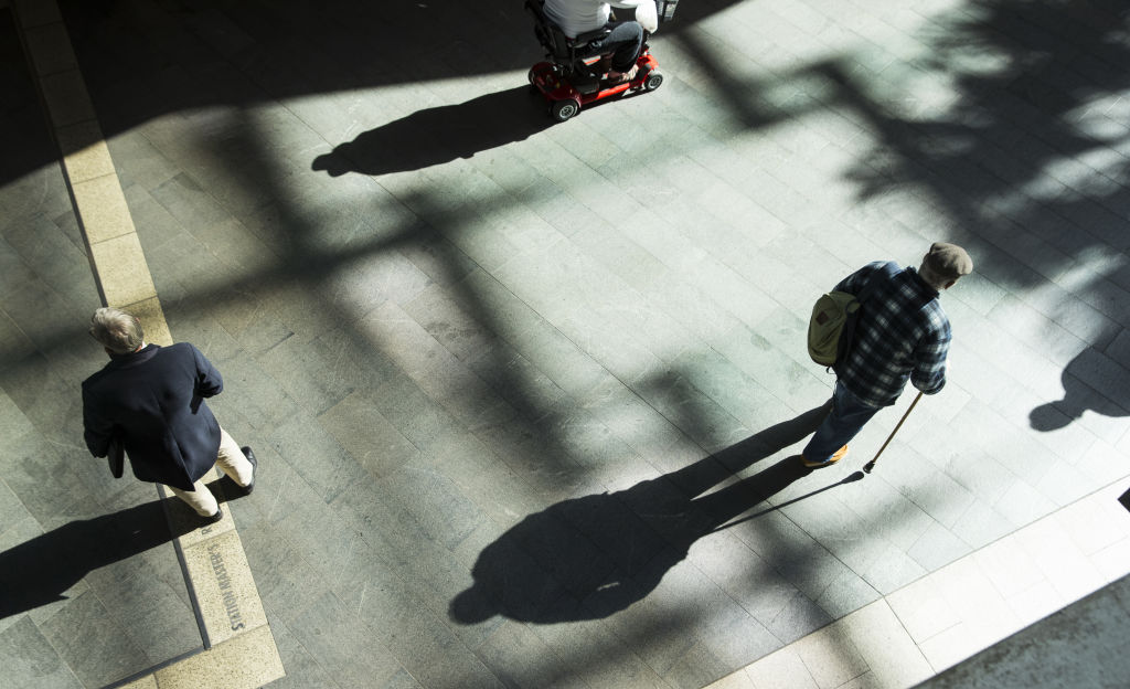 Generic scenes around Chatswood. Elderly, walking stick, mobility scooter, aged care, shadows, old man, waiting, standing. July 2017 AFR photo Louie Douvis