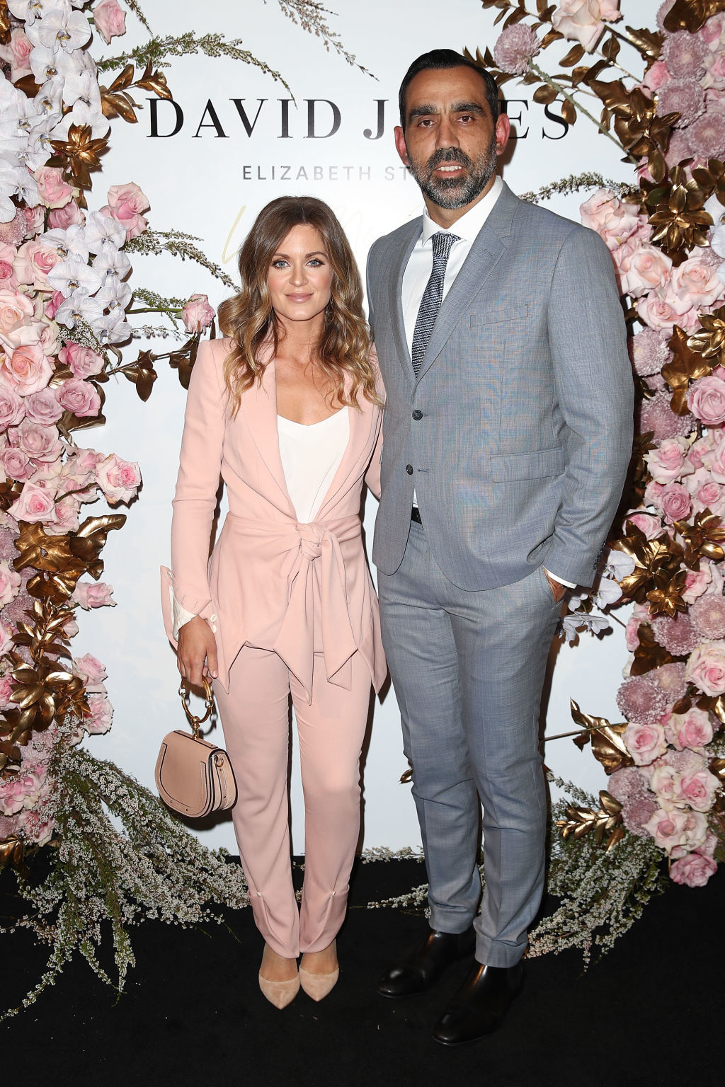 SYDNEY, AUSTRALIA - OCTOBER 04: Natalie Croker and Adam Goodes attend the David Jones luxury shoe floor launch party at David Jones Elizabeth Street Store on October 4, 2018 in Sydney, Australia. (Photo by Brendon Thorne/Getty Images for David Jones)  Adam Goodes and wife Natalie Crocker at the opening of David Jones 7th floor.