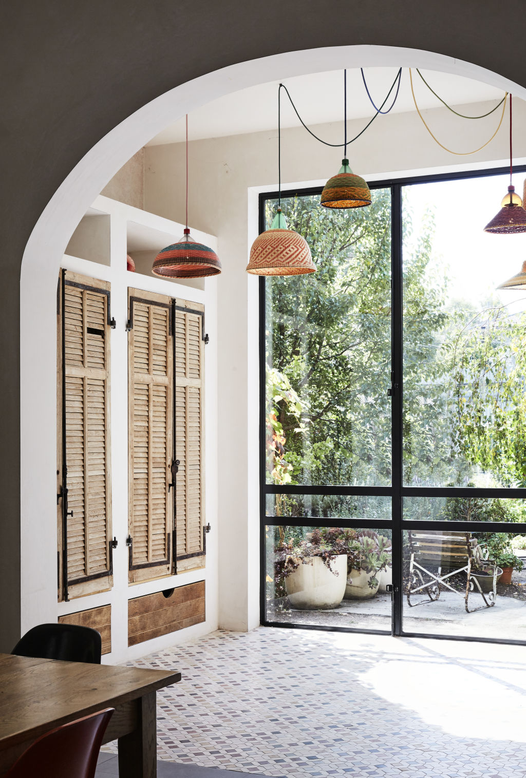 Incredible PET Lamp woven lampshades (using recycled plastic bottles!) from Safari Living. Wooden shutters from Manon bis. Styling: Annie Portelli.