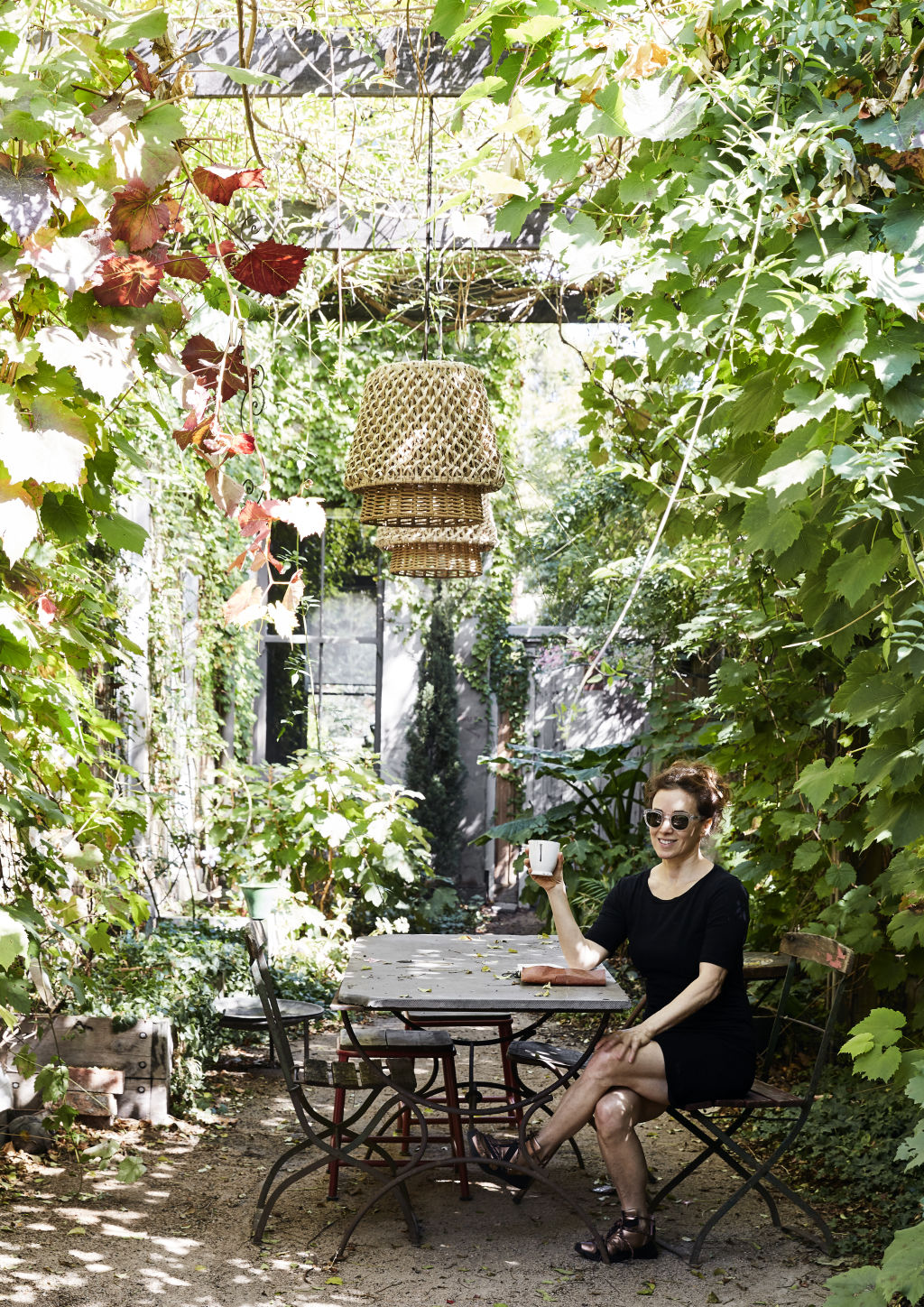 Barb in her lush European garden, which she created with the help of local landscaper Gavin Smith. Styling: Annie Portelli.