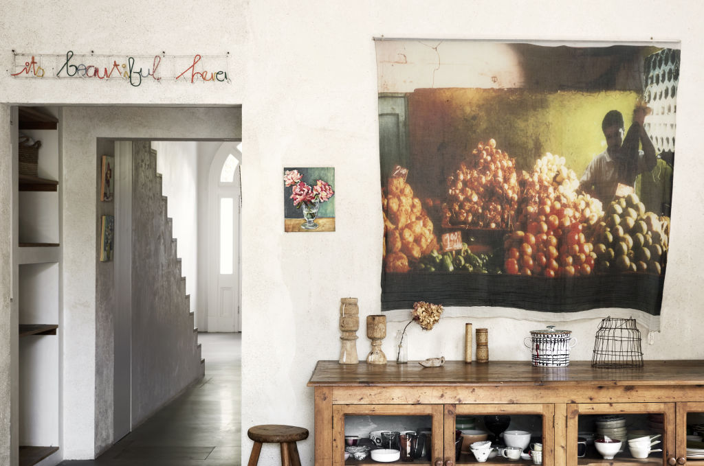 The effortlessly chic St Kilda home of Barb Hyman. Scarf from est Living used as affordable artwork. Kitchen storage cupboard from Izzi and Popo. Styling: Annie Portelli.