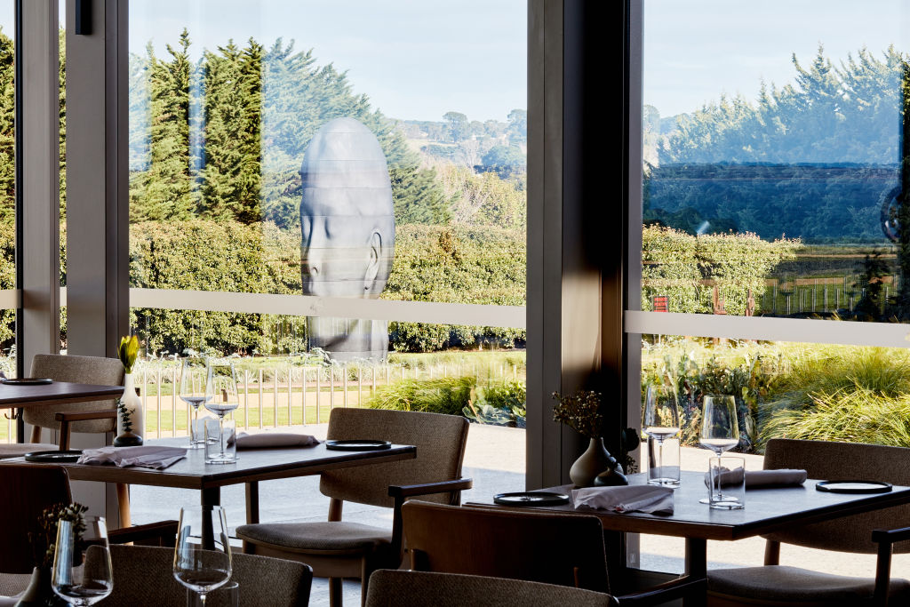 Laura Restaurant with Jaume Plensa, Laura sculpture in background.