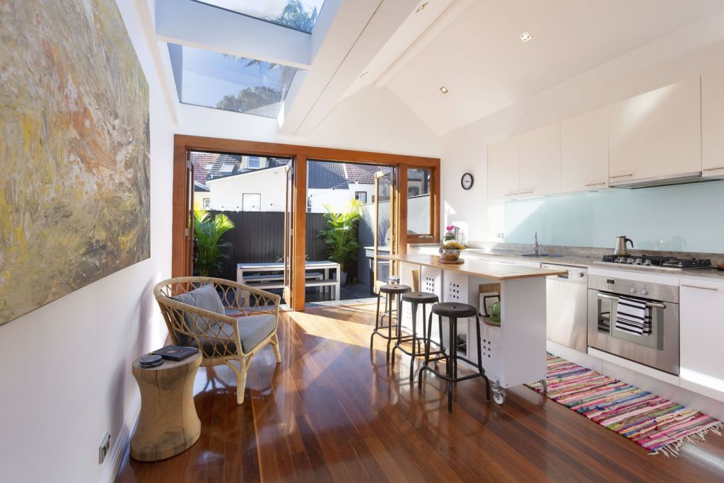 Large bifold or sliding doors coupled with skylights floods a terrace with light and brings the outdoors in.