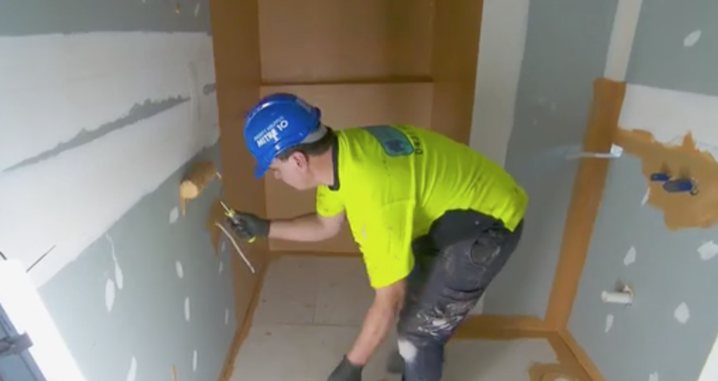 Waterproofing involves applying a membrane to walls and floors to prevent moisture ingress.