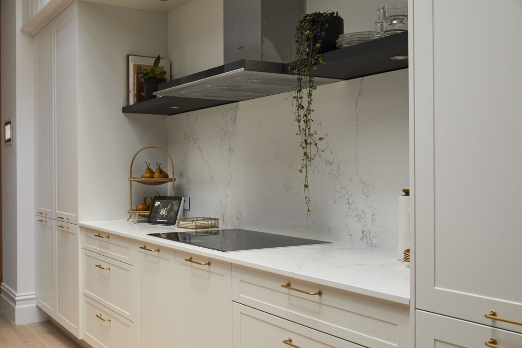 A rangehood suited to a gas cooktop won't work as well with an electric or induction stove, like the one Andy and Deb's kitchen.