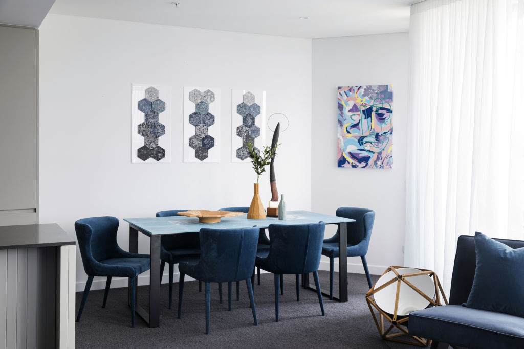 A dining table and artwork made from recycled waste.