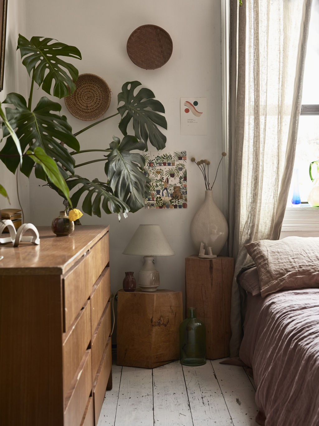 Jenna's home is filled with treasured pieces gifted and made by friends. Ceramic sculptures by HanMade. Prints by Edie Willmett. 'Plant Mama' water colour print by a Slovakian painter, Kristina Kemenikova. Secondhand lamp + vase. Bed Threads bed linen. Styling: Annie Portelli.