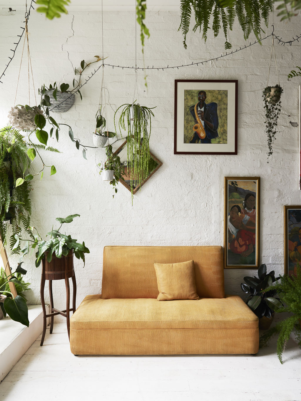 'My most creative work is done in this room. I have created my version of a dream space that encourages and inspires creativity within myself. A lot of my girlfriends who work for themselves will come work with me in the space, we'll play Aretha Franklin, drink wine and throw ideas around the space, it has a good vibe', Jenna tells. Couch + paintings are all secondhand. Styling: Annie Portelli.