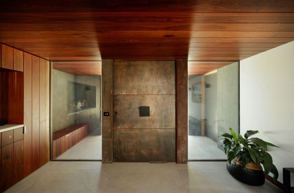 Clad_in_steel_surrounded_by_ironbark_the_new_front_door._Pix_Peter_Hyatt_dtn1yf