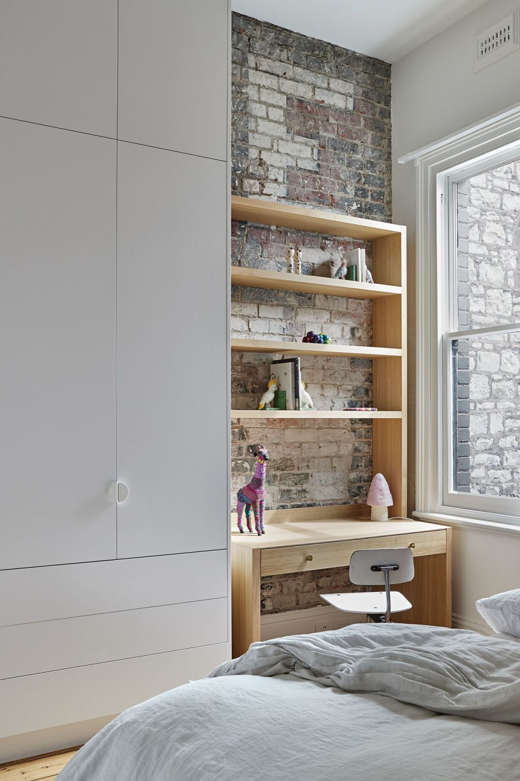 old_stone_and_advertising_daubed_brick_remain_visible_in_a_modern_bedroom._Pix_Shannon_McGrath_ayuozq
