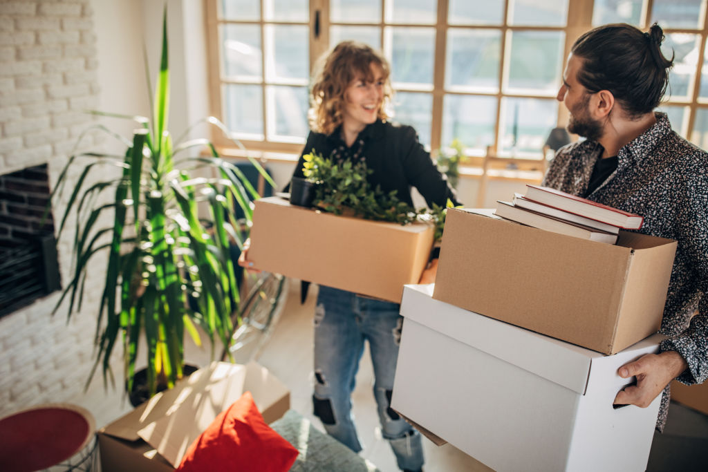 Young couple moving into their new apartment together
