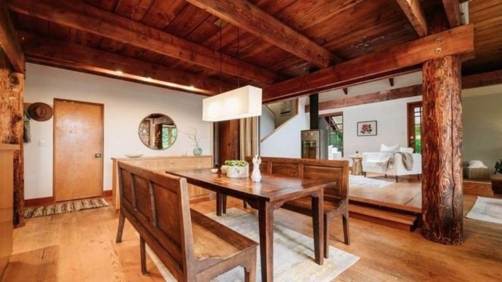 The living area includes four salvaged wood beams from a 100-year-old Douglas fir tree.