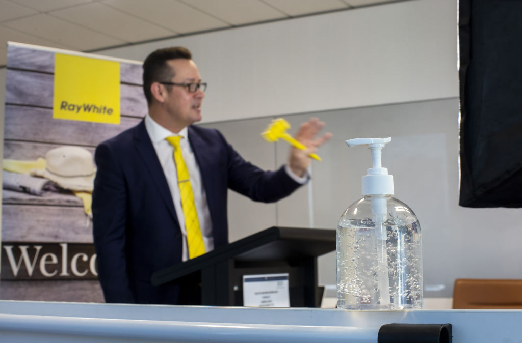 Photo of Ray White auctioneer Jeremy Tyrrell taken by Stephen McKenzie on August 1, 2020 at Ray White's head office in Southbank.