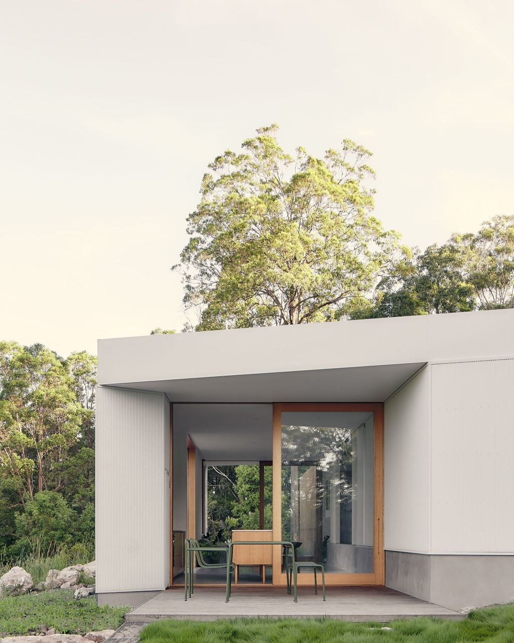 A Sunshine Coast designed for the views by Atelier Chen Hung. The outdoor deck is chipped into the rectilinear floor plan.