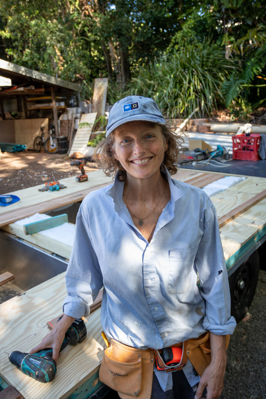 Louise Southerden at work on her tiny house in NSW.