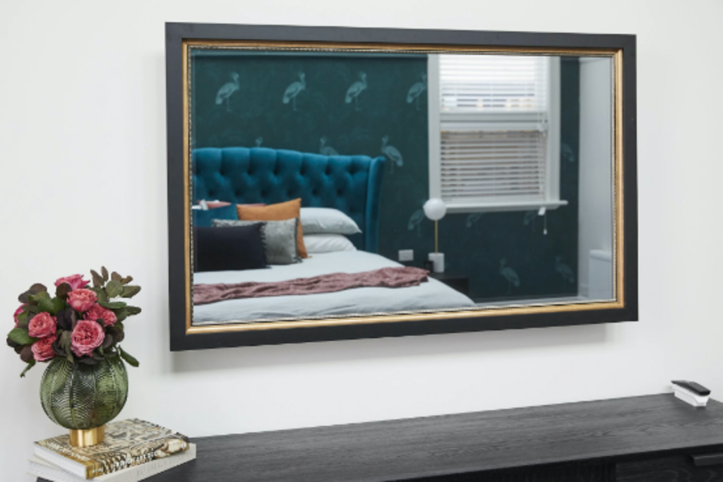FRAMING TO A T TV-MIRROR WITH BLACK SQUARE FRAME AND GOLD EDGING