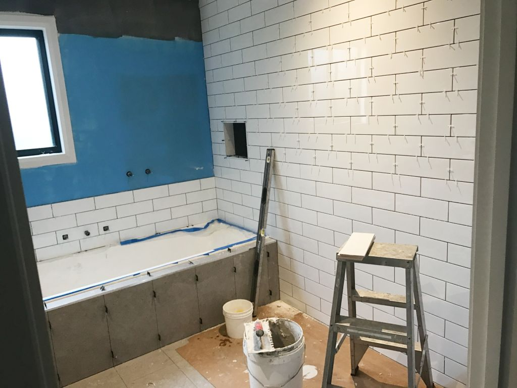 Bathroom renovations require a lot of specialist trades, but self-managing the project can reduce costs.