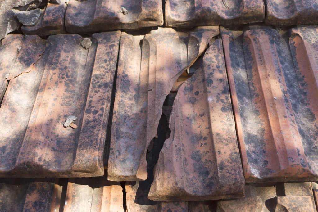 A cracked roof tile in a heavy downpour can cause a severe leak.