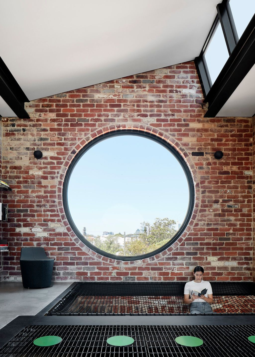 From_inside_and_with_a_big_circular_window_and_suspended_net_for_hanging_out_on_Brick_House_signals_it_s_intention_to_be_playful._Photo_Jack_Lovel_ovrwb1
