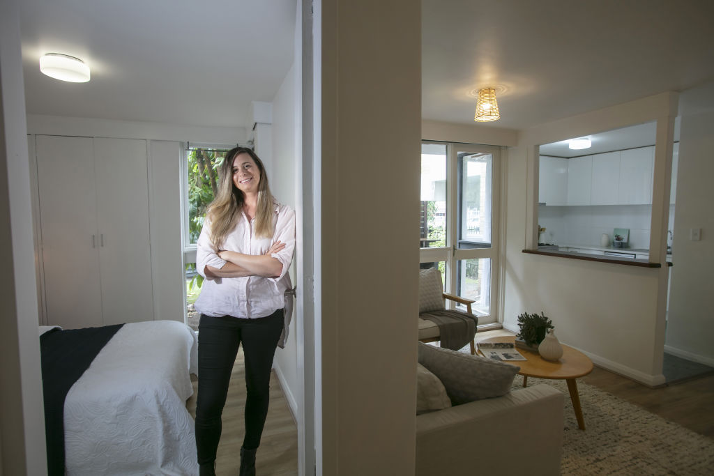 Emma Kelliher in her St Kilda West apartment which is attracting much attention from Melbourne's first home buyer's.