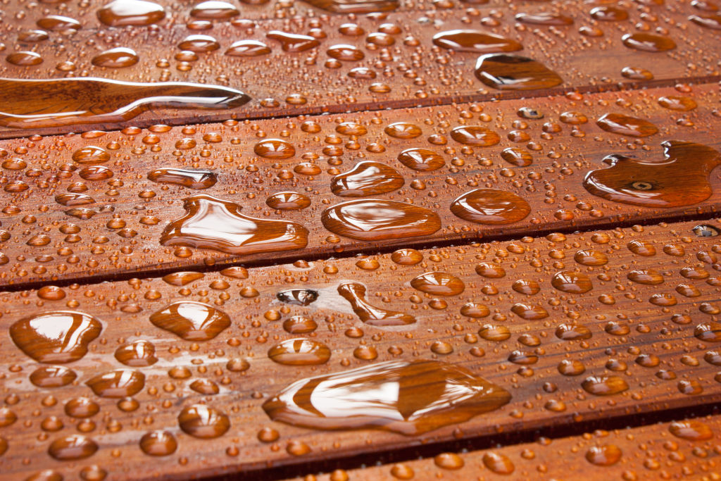 If water is beading on the surface, the deck doesn't need to be refinished.