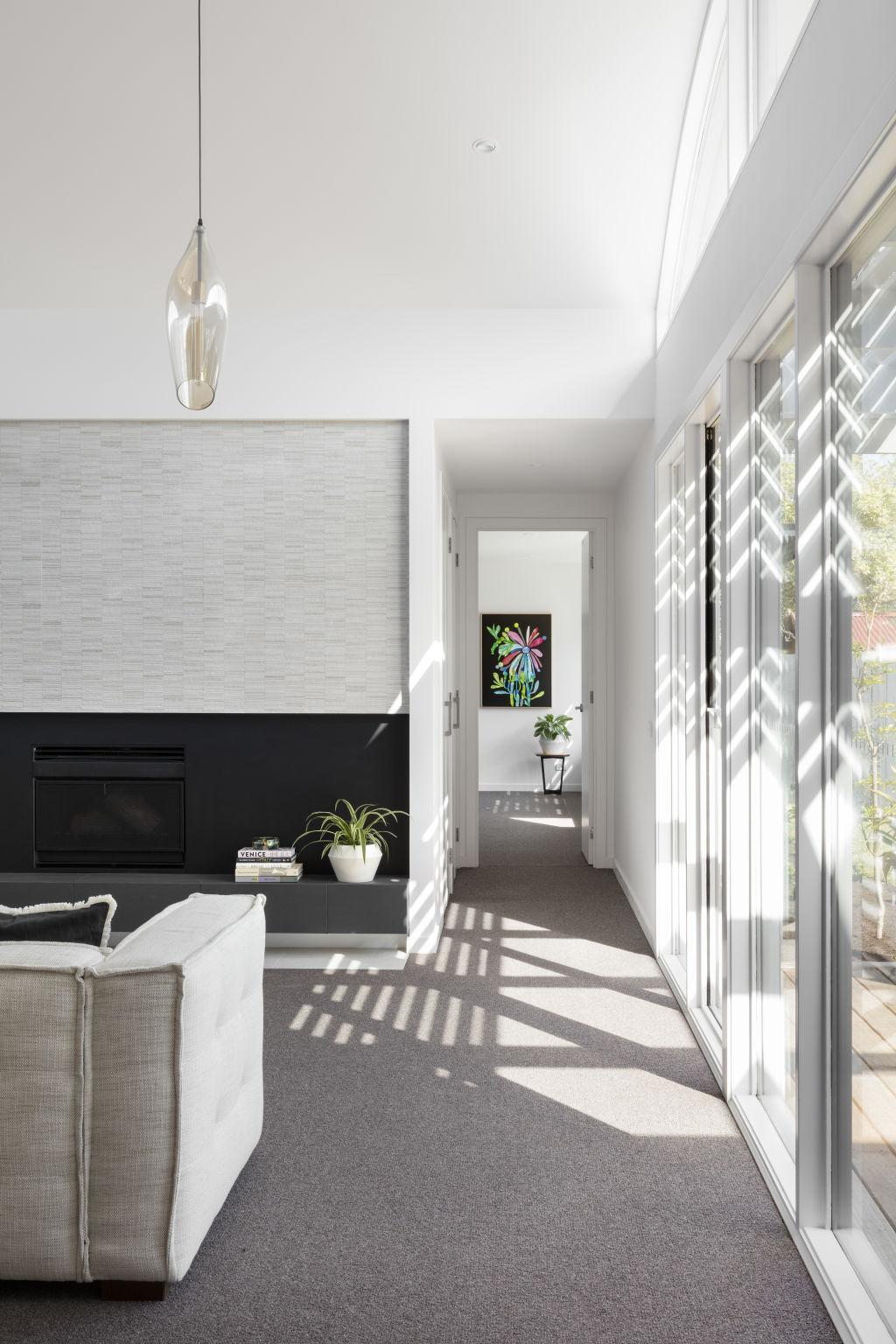 A Fasham design provides depth of sunlight, illuminating a living room and passage.