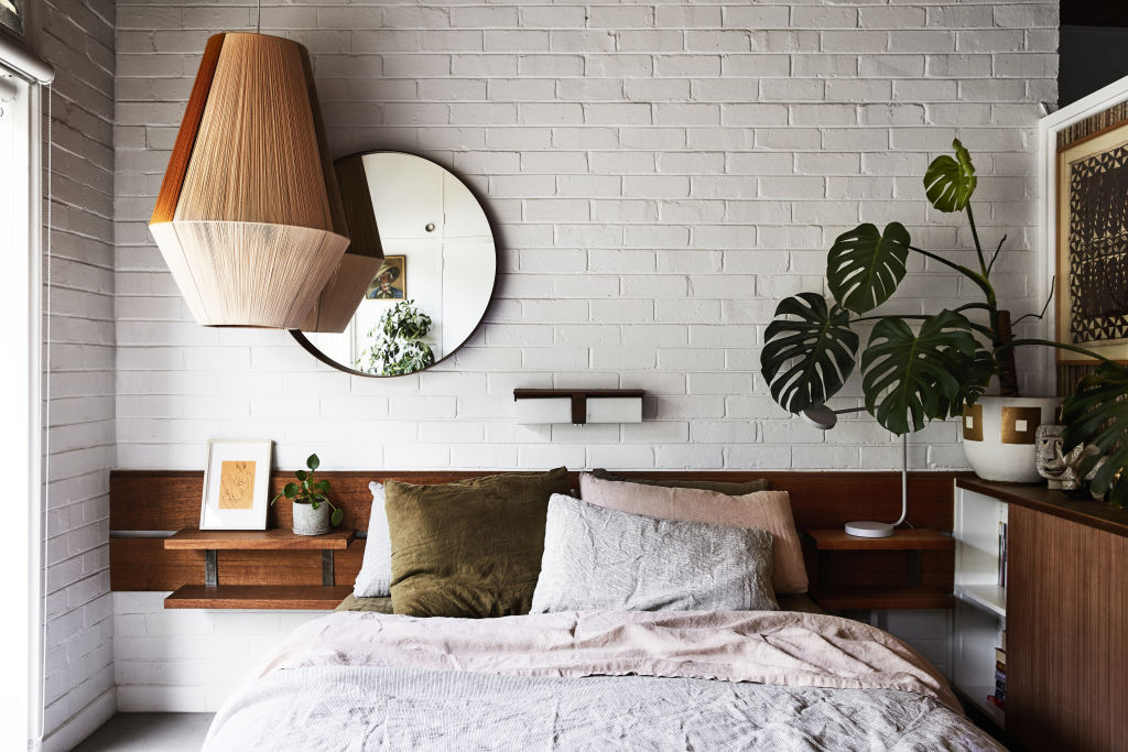 Original bedhead joinery and wall lamp, Pop & Scott 'Dreamweaver' pendant light, Ikea Mirror, Bill Coleman ink drawing, Mark Gambino ceramic pot. The bedlinen a mix of Sage and Clare and Deiji Studios.  Styling: Annie Portelli.