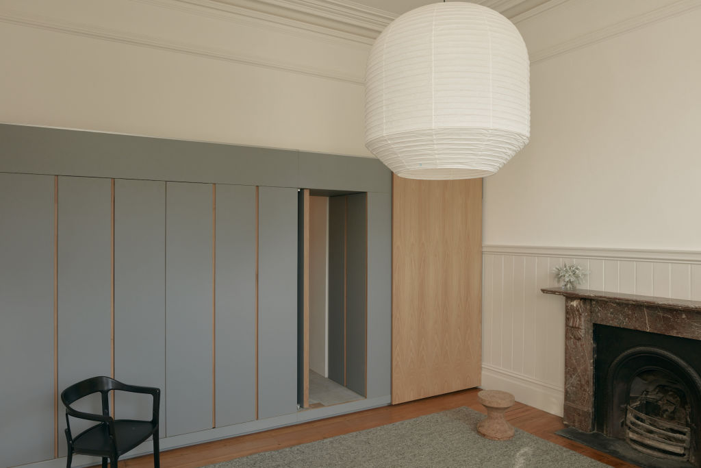 IN_what_was_the_old_Collingwood_football_club_rooms_a_joinery_insertion_conceals_a_kitchenette_a_fold-down_bed_and_the_door_to_a_bathroom._Photo_Tom_Ross_wmbvuh