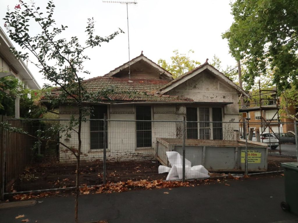 Before the tired, old house was recovered by new owners and heritage experts Lovell Chen.