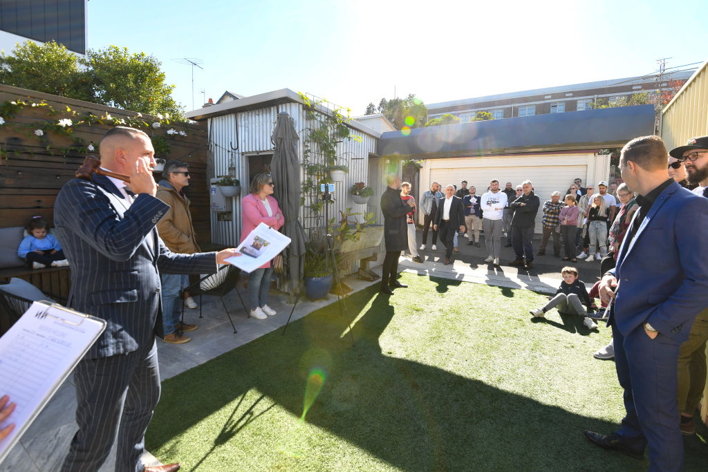 Domain  Saturday Auction Story  Tawar Razaghi-auction by Adrian William of a freestanding 3br period home near Enmore Park  at 59 Addison Road Marrickville. Photo shows, Auctioneer Clarence White during the successful auction.  Photo by Peter Rae. Saturday 5 June 2021