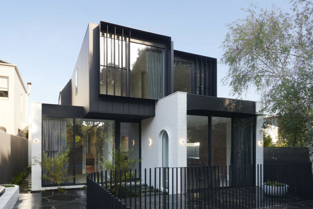 The two-storey extension may be rectangular but the arch reappears. For Toorak architecture story.