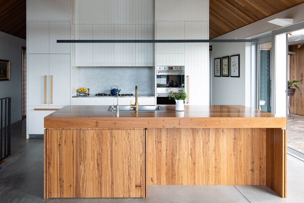 A combination of Blackbutt veneer with a butcher's block-type surace, the timber island is the main element of the kitchen area. Wagstaffe House.
