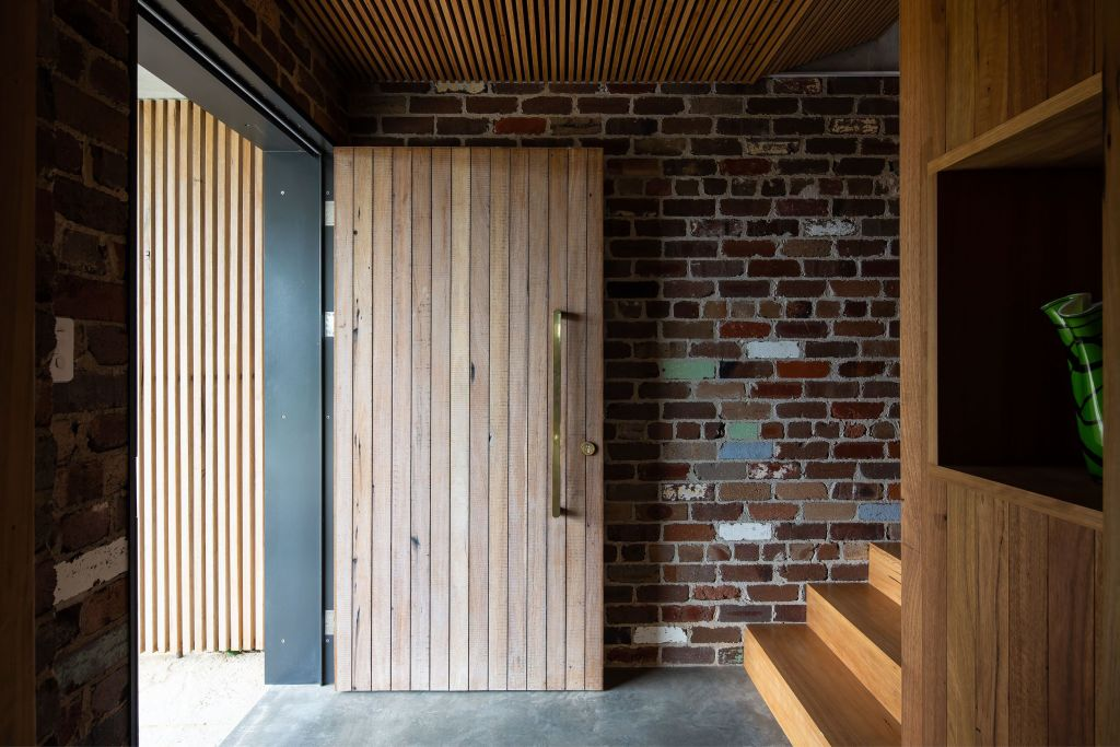 Compressed and materially heavy, the entry invites a journey upstairs into the light and water views. Wagstaffe House.